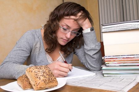 bend over: Pretty brunette bend over her books and studying hard Stock Photo