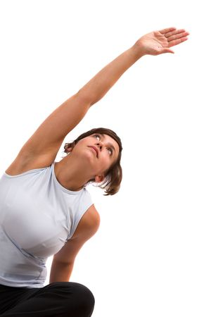 Beautiful brunette reaching up after her workout stretching her muscles Stock Photo - 585237