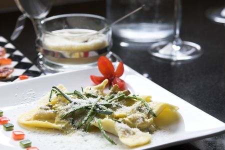 Italian pasta dish with slices of courgette and sprinkled with parmesan cheese Stock Photo - 608033