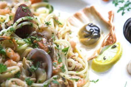 seafruit: Closeup of seafood dish with mussels, squid and shrimp in spaghetti