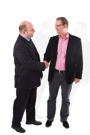 Two businessman having just come to an agreement and shaking eachother's hand on the deal Stock Photo - 649219