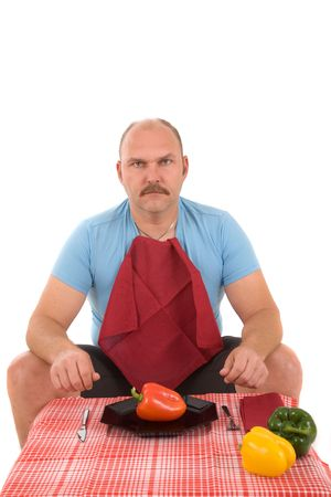 Overweight man looking very unhappy with a plate with a pepper on it photo
