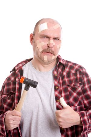 Man with a hammer and covered in bandaids photo