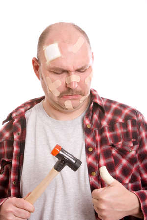 Adult man having hit his thumb with the hammer Stock Photo - 3010240
