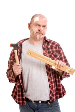 doityourself: Mature handyman with his head covered in bandaids Stock Photo