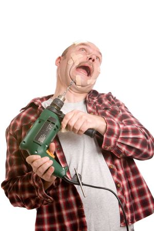 clumsy: Clumsy handyman struggling with the drill while having his face already covered in bandaids
