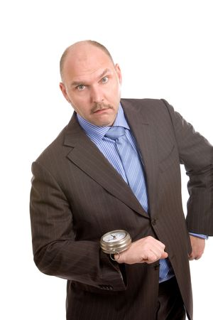 Adult businessman looking very shocked at the huge watch on his wrist