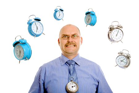 Businessman looking very stressed while various clocks are swirling around his head photo