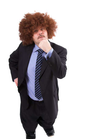 midget: Tiny businessman shaking his fist and wearing a afro wig Stock Photo