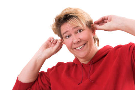 sidewards: Woman pulling her ears sidewards with a funny face Stock Photo