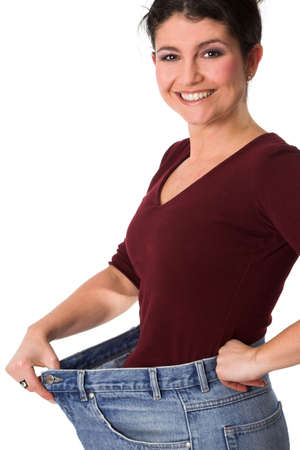 baggy: Pretty brunette wearing a jeans that is far too big, showing her slim waist