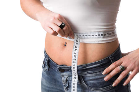 bare waist: Woman measuring her waist with measuring tape Stock Photo