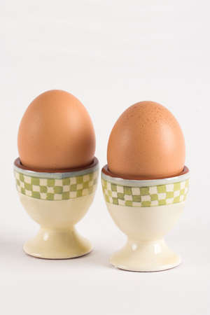 eggcup: Two boiled eggs in egg-cup Stock Photo