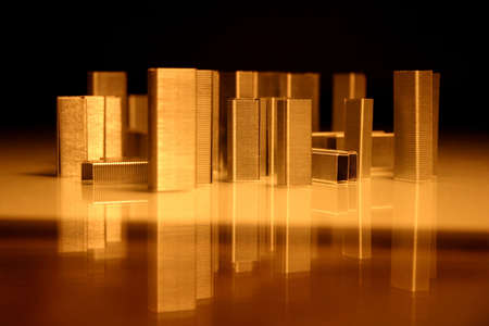 undertaking: Business concept. City of staples. Simple staples looks like a city. Reflection of buildings on the water. Stock Photo