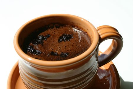 ceramicist: A cup of coffee on white background