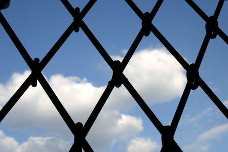 beyond: Conceptual: sky beyond the fence Stock Photo