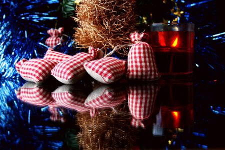 Christmas decorations, gifts, candle and reflections on the glass. Stock Photo - 239833