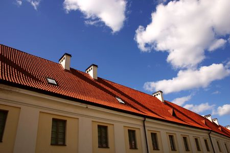 housetop: Roof, chimneys and the sky Stock Photo