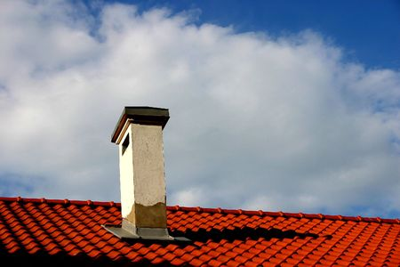 Roof, chimney and the sky