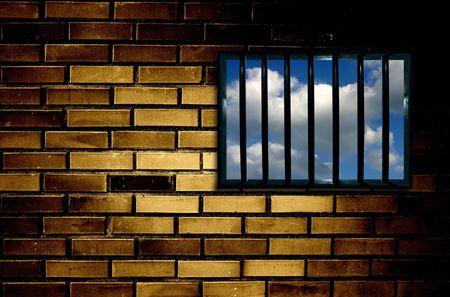 limbo: Latticed prison window, clear sky beyond Stock Photo
