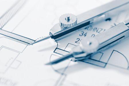compass on a blueprint, close up