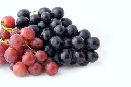 bunch of isolated dark and red grapes on white background