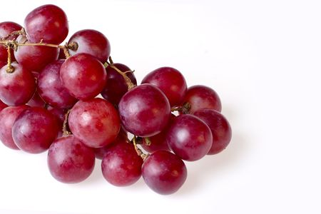 bunch of isolated red grapes on white background Stock Photo