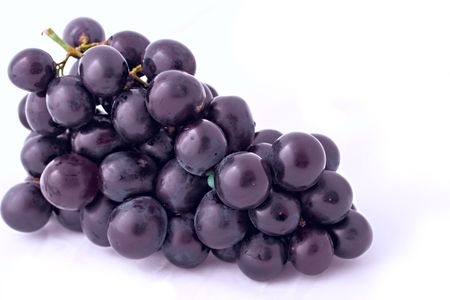 bunch of isolated dark grapes on white background