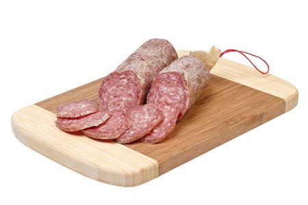 sliced salami on wooden plate