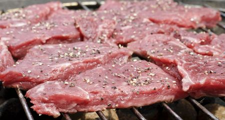 BBQ Steaks close up almost raw