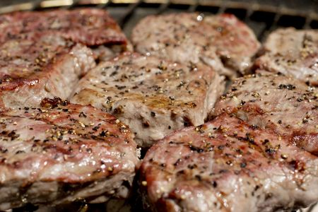 Close up of steaks on BBQ Grill