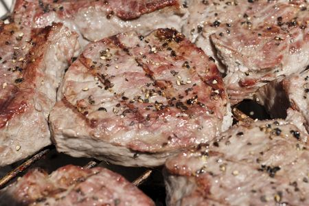 Close up of steaks on BBQ Grill Stock Photo - 3067519