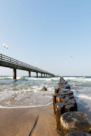 windy beach with sea bridge baltic sea