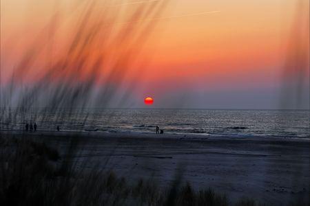 Sunset on beach, baltic sea Stock Photo