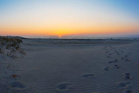 sunset on beach wide angle view, baltic sea