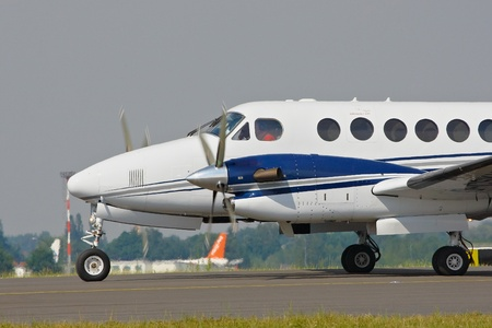 corporate airplane on taxiway engine running