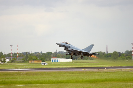 Fighter jet taking off with afterburner Stock Photo - 10050222