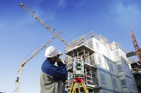 engineer measuring and surveying inside construction industry Stock Photo