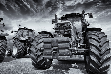 farming tractors and tires in a line-up