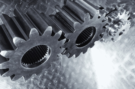 giant industrial cogwheels, titanium and steel engineering parts Stock Photo