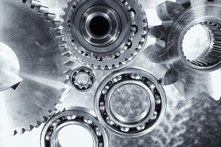 titanium: titanium and steel engineering parts set against brushed aluminum