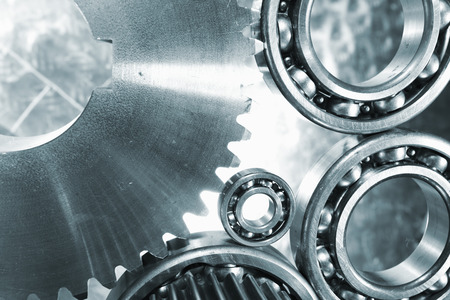 gears, cogwheels and ball-bearings in titanium and steel, blue toning concept Stock Photo