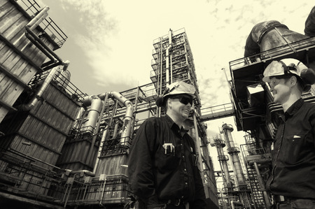 oil and gas workers inside refinery industry, analog look  Stock Photo