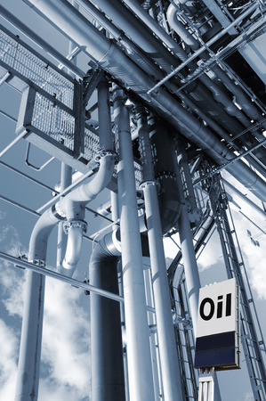 chemical engineering: industrial pipelines and  oil  sign inside refinery