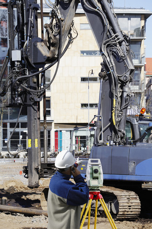 surveyors measuring instrument inside construction site