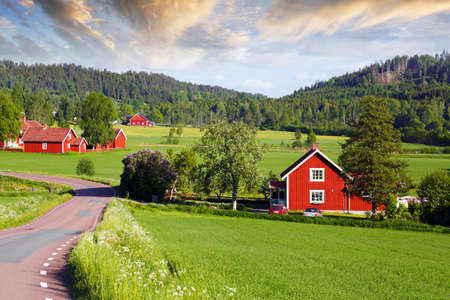 red farm houses in old rural landscape, Sweden