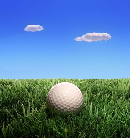 Golf ball on plastic grass