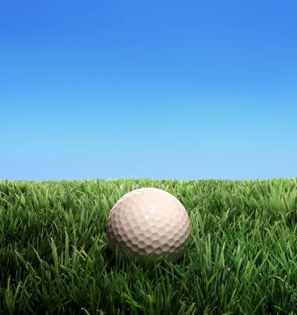 Golf ball on a plastic grass