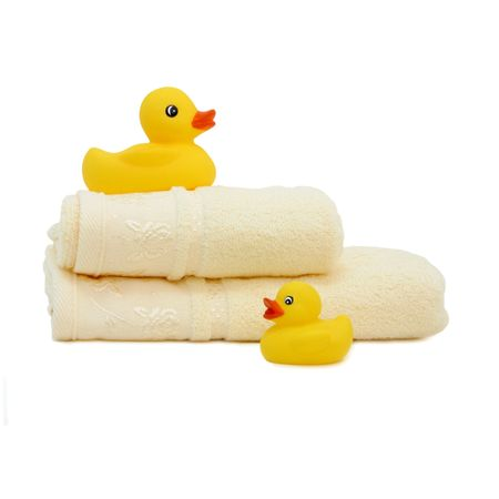 Rubber duckies with floded towels isolated