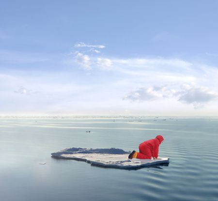The practical side of Global Warming research. A scientist stranded on an ice floe.  Stock Photo